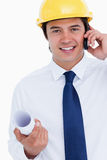 Smiling male architect on his cellphone Stock Image