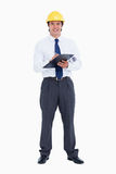 Smiling male architect with pen and clipboard Stock Photography