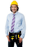 Smiling male architect wearing tool belt Stock Photos