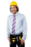 Smiling male architect wearing tool belt Stock Photography