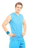 Smiling male athlete in sportswear posing Stock Photo