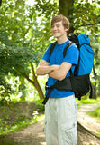 Smiling male backpacker. Smiling male tourist with backpack on the road Stock Images