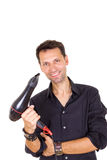 Smiling male barber with hair dryer Stock Photo