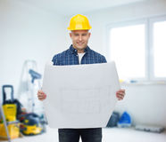 Smiling male builder in helmet with blueprint Stock Images
