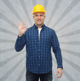 Smiling male builder in helmet showing ok sign Stock Photography