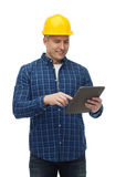 Smiling male builder in helmet with tablet pc. Repair, construction, building, people and maintenance concept - smiling male builder or manual worker in helmet Royalty Free Stock Photo