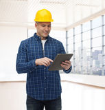 Smiling male builder in helmet with tablet pc Stock Images