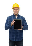 Smiling male builder in helmet with tablet pc. Repair, construction, building, people and maintenance concept - smiling male builder or manual worker in helmet Stock Photos