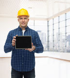 Smiling male builder in helmet with tablet pc Stock Photo