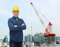 Smiling male builder or manual worker in helmet Stock Images
