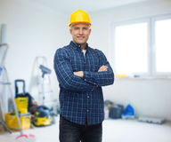Smiling male builder or manual worker in helmet Royalty Free Stock Photography
