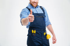 Smiling male builder showing thumb up Royalty Free Stock Images