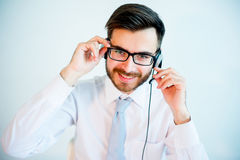 Smiling male call center operator. At work Stock Photos