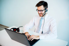 Smiling male call center operator. At work Royalty Free Stock Images