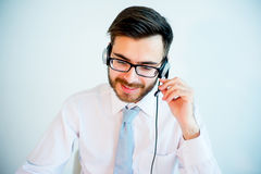 Smiling male call center operator. At work Royalty Free Stock Photos