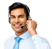 Smiling Male Call Center Representative Wearing Headset. Portrait of smiling male call center representative wearing headset over white background. Horizontal Stock Images