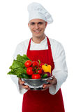Smiling male chef with fresh vegetables Stock Photo