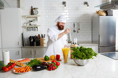 Smiling male chef prepare his kitchen for began to cook Royalty Free Stock Photography