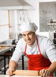 Smiling Male Chef Rolling Pasta Sheet At Counter Stock Photos