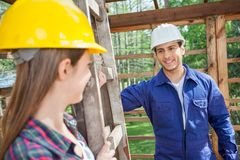 Smiling Male Construction Worker Looking At Female Stock Image