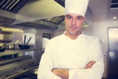 Smiling male cook with arms crossed in kitchen Stock Photo
