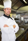 Smiling male cook with arms crossed in kitchen Royalty Free Stock Photo