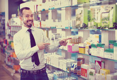 Smiling male customer looking for right medicine Stock Photography