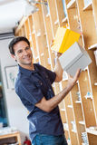 Smiling Male Customer Removing Cardboard Boxes Stock Photo