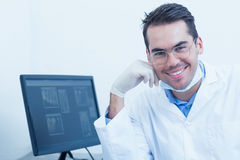 Smiling male dentist with computer Royalty Free Stock Image