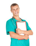 Smiling male doctor with blank clipboard Royalty Free Stock Images