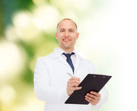 Smiling male doctor with clipboard Stock Image