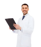 Smiling male doctor with clipboard Royalty Free Stock Photo
