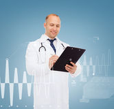 Smiling male doctor with clipboard and stethoscope Stock Photos