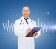 Smiling male doctor with clipboard and stethoscope Stock Images