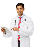 Smiling Male Doctor Holding Digital Tablet Stock Photo