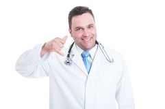 Smiling male doctor or medic making call me gesture Stock Photo