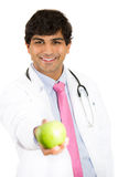 smiling male doctor or nurse with stethoscope offering you a green apple Stock Photos