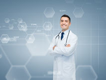 Smiling male doctor over chemical formula Stock Photo