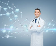 Smiling male doctor over molecule formula Stock Image