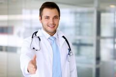 Smiling male doctor is ready for handshake Stock Photo