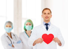 Smiling male doctor with red heart Stock Photography