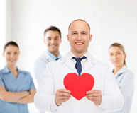 Smiling male doctor with red heart Royalty Free Stock Image