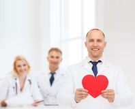 Smiling male doctor with red heart Royalty Free Stock Photo