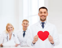 Smiling male doctor with red heart Stock Photo