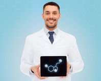 Smiling male doctor showing tablet pc screen Stock Photography