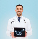 Smiling male doctor showing tablet pc screen Royalty Free Stock Photography