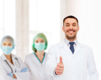 Smiling male doctor showing thumbs up Royalty Free Stock Photography