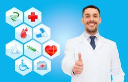 Smiling male doctor with stethoscope Stock Images
