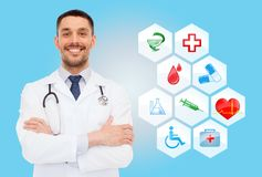 Smiling male doctor with stethoscope Stock Image