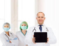 Smiling male doctor with stethoscope and tablet pc Royalty Free Stock Photo